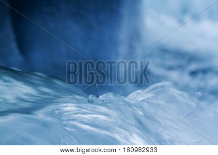 Water flow on river in winter with ice