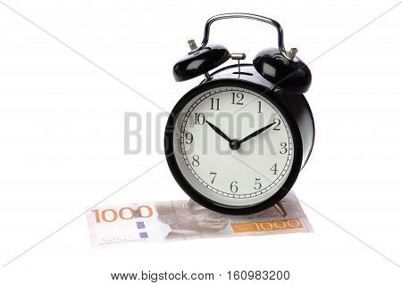 One black alarm clock on a Swedish 1000 krona banknote isolated on white background.