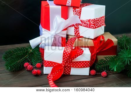 Gift Box Tied With A Red Ribbon , Fir Branches,candy