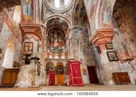 KUTAISI, GEORGIA - SEP 22, 2016: Nave of the church with ancient frescoes of medieval monastic complex Gelati on September 22, 2016. Gelati monastery was built in 12th century UNESCO World Heritage Site.