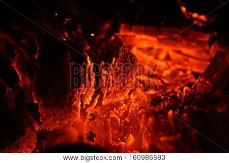 close up view of glowing hot embers in a fire place