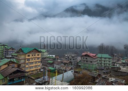 Himalayan town Lachen North Sikkim on a foggy winter morning. The town forms the base to the Chopta Valley and Gurudongmar Lake.