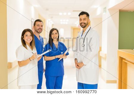 Doctor And Interns Standing In A Hallway