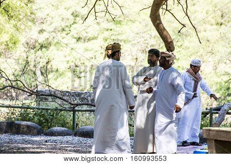 Oman Salalah - Local arab people talking during Jeep Tour at Wadi Derbat in the Sultanate green oasis 17.10.2016.