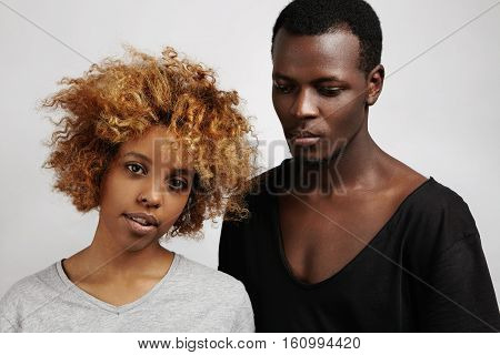 People,style And Fashion. Indoor Shot Of Young African Couple Posing Together In Studio: Pretty Girl