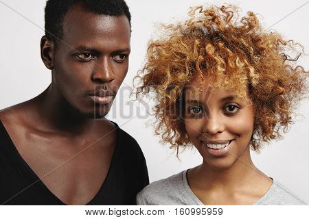 Two African Models Dressed Casually Posing In Studio. Pretty Girl With Afro Hairstyle And Facial Pie