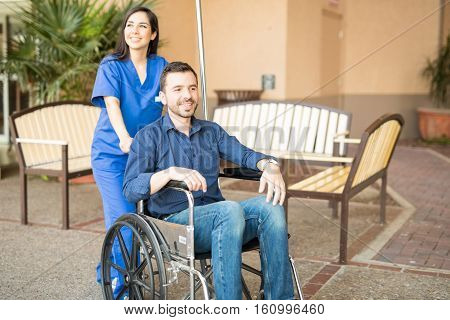 Patient In Wheelchair Going For Stroll