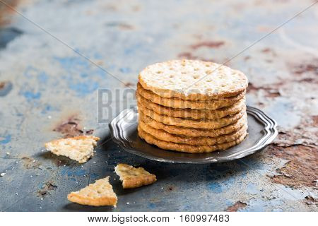 Homemade shortbread cookies with quinoa on old metal background with copy space.