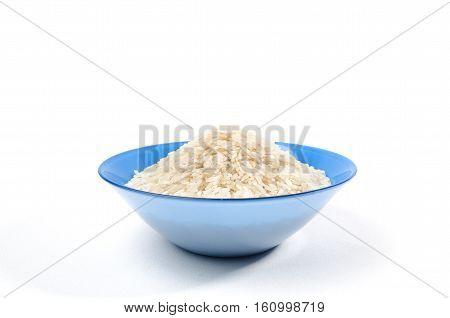 handful of long-grain rice isolated in the blue cup on center