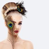 Glamorous Blonde Woman with Perfect Hairstyle Makeup and Peacock Feathers poster