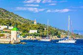 Waterfront view at coastline in town Bol on Island Brac, popular touristic destination on Adriatic Sea, Croatia. poster