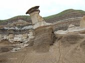 Photo of a natural wind eroded feature called a Hoodoo in dinosaur country at Drumheller in Alberta Canada. poster