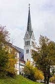 Wiev of Church tower. Neo Gothic Parish Church of Saint Martin at Bled lake in Slovenia poster