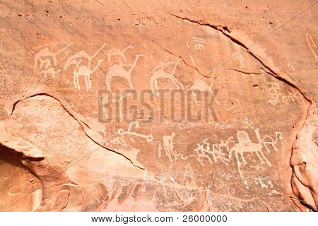 Images of  camels carved into a rock wall at Wadi Rum, a UNESCO World Heritage site in Jordan.