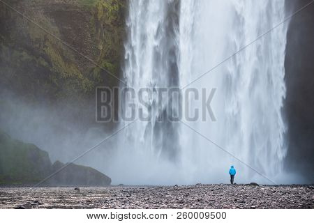 Skogafoss - huge waterfall on the Skoga river in the south of Iceland at the cliffs. Tourist walks near the cascade poster