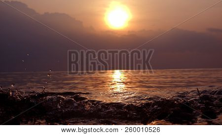 Sunset. Beautiful Sunset Baltic Sea. Sunset With Sea Wave On The Front With Bokeh Background Sunset.