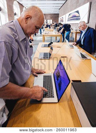 Strasbourg, France - Sep 21, 2018: Two Seniors Men Testing Aplle Macbook Pro 15 2018 Laptops In Appl