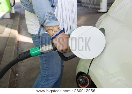 Gronau, Germany - Aug 16, 2018: A Woman Is Filling Her Car With Fuel At A Filling Station