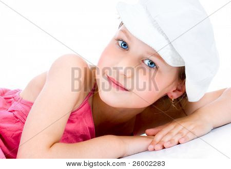 Cute little girl with white cap posing  , studio shot