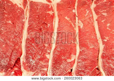 Full Frame Texture Of Raw Flat Iron Steaks, Butlers Steaks Or Oyster Blade Steaks Showing The Grain