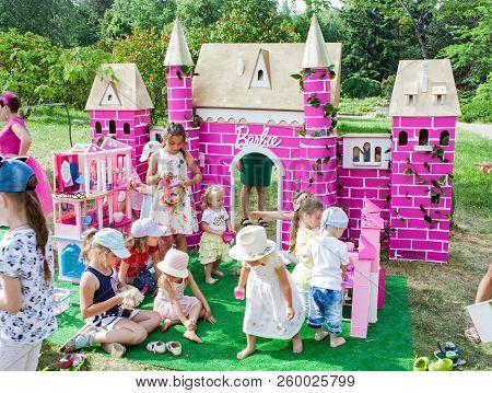 Minsk, Belarus, June 3, 2018: Children Play With Dolls On The Playground Barbie