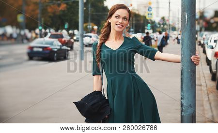 Happy Pretty Woman On A Street