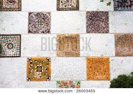 "BARCELONA,SPAIN-OCTOBER 1: The mosaic tiles wall  in the park Guell, designed by Antonio Gaudi, on October 1., 2010 in Barcelona. Part of the UNESCO World Heritage Site ""Works of Antonio Gaudi""."