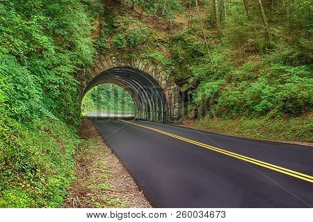 Horizontal Shot Of A New Blacktop Road Going Through A Tunnel In The Smoky Mountains National Park I