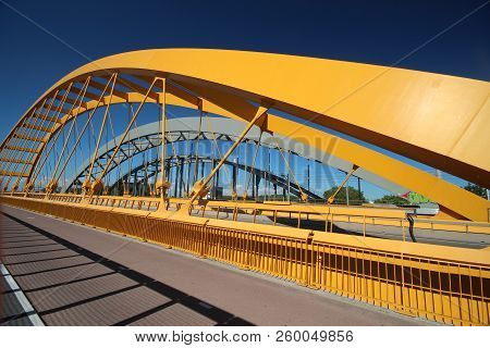 Bright Yellow Bridge Named Hogeweidebrug Over The Amsterdam-rhine Canal In Utrecht For Traffic And V