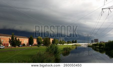 Shelf Cloud Above The Nesselande District In Rotterdam, The Netherlands Where An Aircraft Is Flying