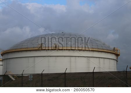 Storage Tank At Refinery In Rotterdam To Store Oil Of Fuel In The Netherlands