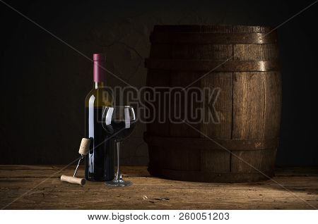 Wine Tasting Experience In The Rustic Cellar And Wine Bar: Red Wine Glass And Collection Of Excellen