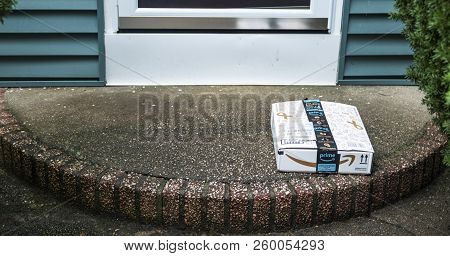 Babylon, New York, Usa - 13 September 2018: A Package Is Left On A Front Porch And Is Vulnerable To