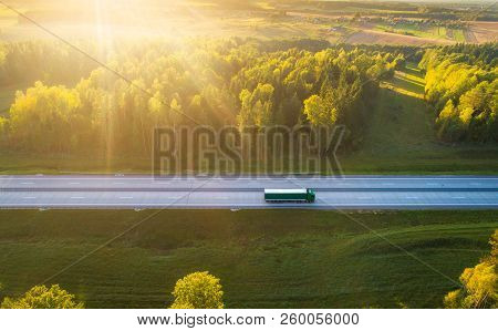 Truck On Highway. Truck Moving On Road In Evening. Cargo Transportation Background. Cargo Shipping.