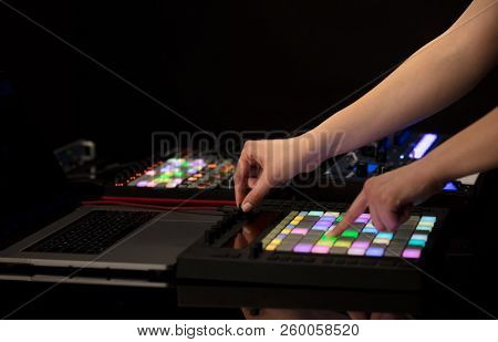 Dj hand remixing music on midi controller poster