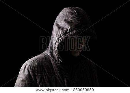 Lonely, depressed and fragile Caucasian or white man hiding face, standing in the darkness. Low key, black background. Concept for loneliness, depression, sadness and mental health issues poster