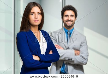 Business couple in a modern office