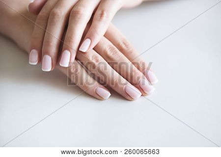 Manicured Hands On Towel. French Manicure. Spa Salon.
