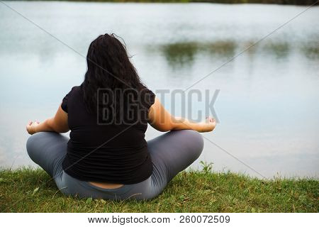 Body Positive, Yoga, Meditation, Relax. Overweight Woman Meditating Outdoors