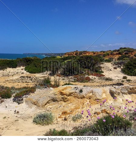 Desolate Area By The Sea, Sea Cliffs, Steep Cliffs, Hot Sunny Day, Clear Blue Sky, Waters Of The Atl