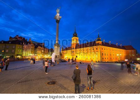 Warsaw, Poland - September 5, 2018: People on the Royal Castle square in Warsaw city at night, Poland. Warsaw is the capital and largest city of Poland.