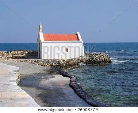 Small Church On The Mediterranean Coast In Crete. Greece