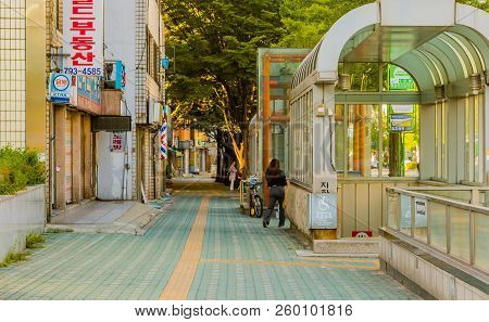 Seoul,south Korea; September 9,2018: Early Morning Empty Sidewalk With Unidentified Woman Next To Su