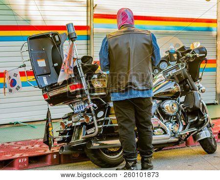 Man Prepares To Ride Motorcycle