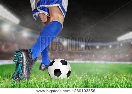 Soccer Player Dribbling Football In Outdoor Stadium With Copy Space