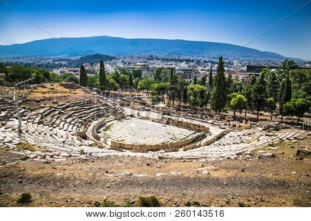 Panoramic view of the Theatre of Dionysus at the foot of Acropolis in Athens, Greece. It is one of the main landmark of Athens. Scenic panorama of ancient Greek ruins of Theatre of Dionysus.