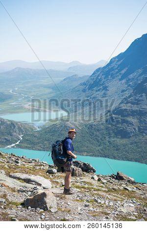 Hiker Standing On Besseggen Ridge In Jotunheimen National Park, Norway