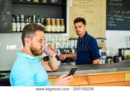 Have Sip Of Energy. Man Client With Beard Enjoy Coffee In Paper Cup. Drinks To Go Useful Option In M