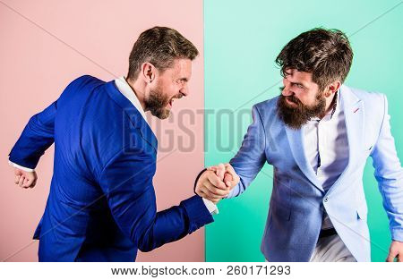 Business Competition And Confrontation. Hostile Or Argumentative Situation Between Opposing Colleagu