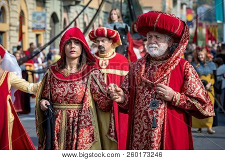 ALBA, ITALY - OCTOBER 01, 2017:  People in historic dresses on Medieval Parade - traditional costumed procession as part of celebrations during annual White Truffle festival in Alba, Italy.